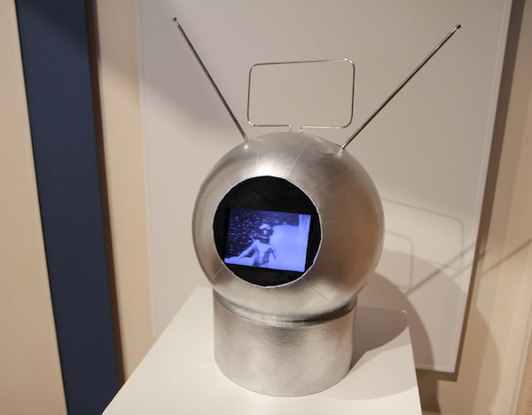 Space Helmet. Globe, papier mache box, antennae, plastic tubes, spray paint, plastic film, video monitor, 2 minute digital video loop