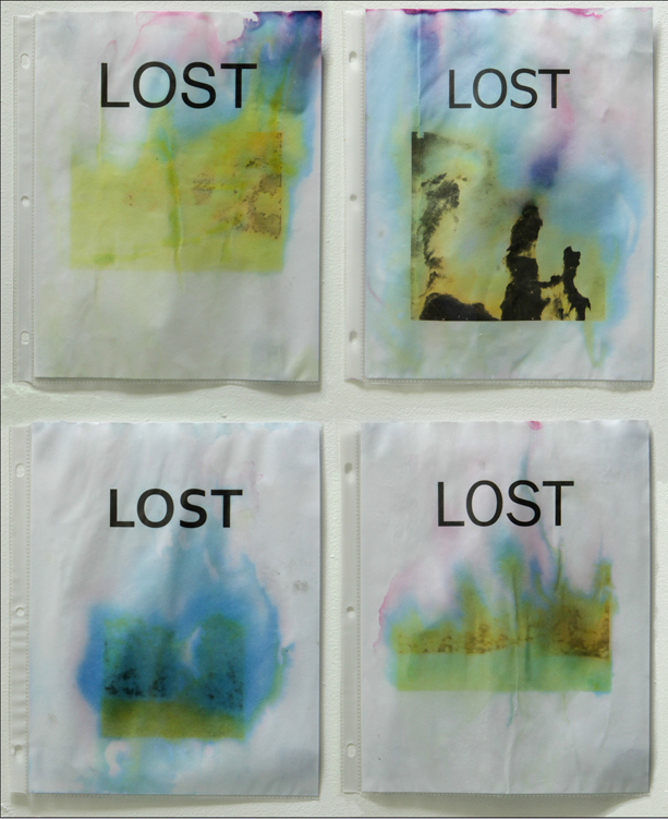 Lost. Inkjet on paper, exposed to water and sunlight, in plastic sheet protectors