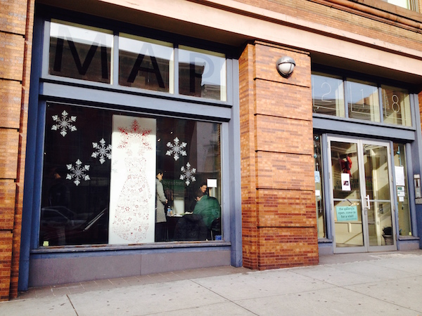 MAP's Front Window with cut out image by Joan Cox